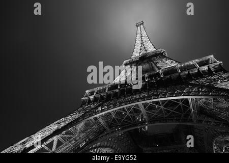 Eiffel tower in Paris at night, black and white, low angle view - Stock Photo