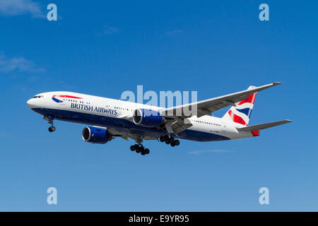 British Airways Boeing 777, G-YMMP, on its approach for landing at London Heathrow, England, UK - Stock Photo