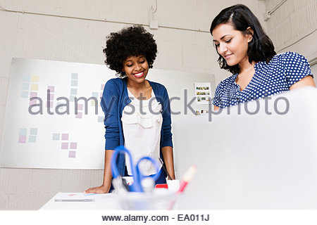 Woman in office of Small Business, Start-up - Stock Photo