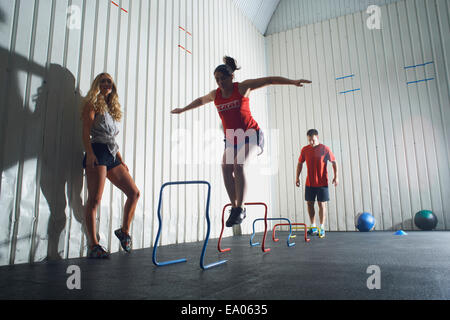 People working out in gym - Stock Photo