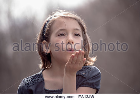 Portrait of pretty girl blowing a kiss - Stock Photo