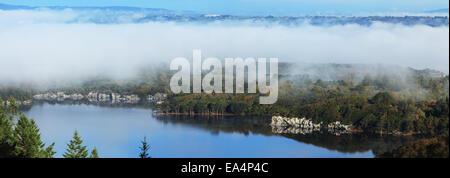 Low cloud hanging over Muckross Lake; Killarney, County Kerry, Ireland - Stock Photo