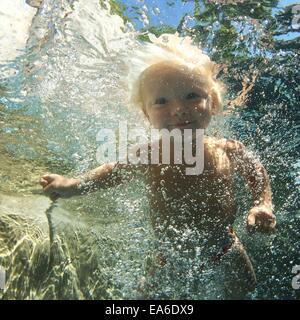 Boy underwater - Stock Photo