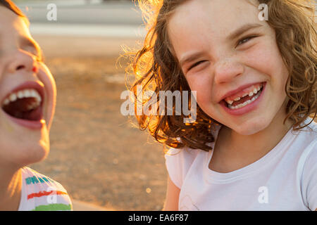 Two happy children laughing - Stock Photo