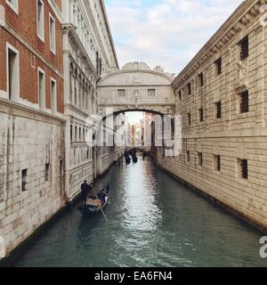Italy, Venice, View of gondolas in canal - Stock Photo