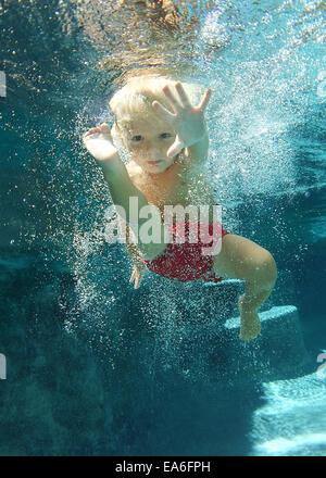 Boy (2-3 years) swimming underwater - Stock Photo