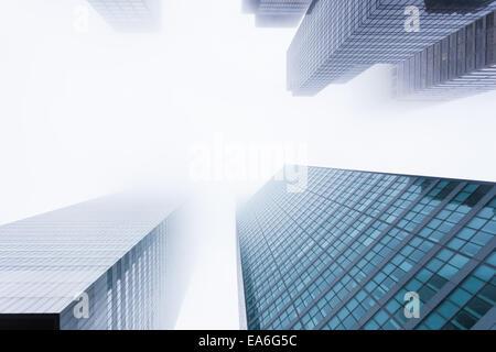 USA, New York State, New York City, Manhattan, View of skyscrapers in mist - Stock Photo