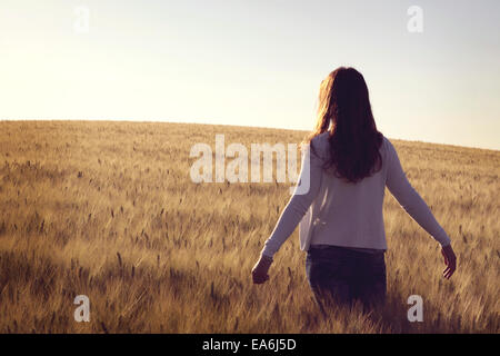 Woman standing in wheat field - Stock Photo