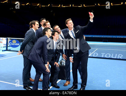 London, UK. 7th Nov, 2014. Tomas Berdych (1st, R) of Czech Republic takes a group selfie with fellow tennis players - Stock Photo