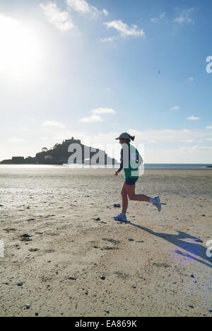 Mounts Bay Harriers running race across the sand at low tide with St Michaels Mount in background Marazion Penzance - Stock Photo