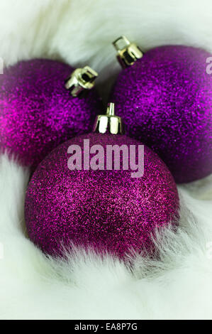 Purple Christmas Decorations On White Fur Stock Photo
