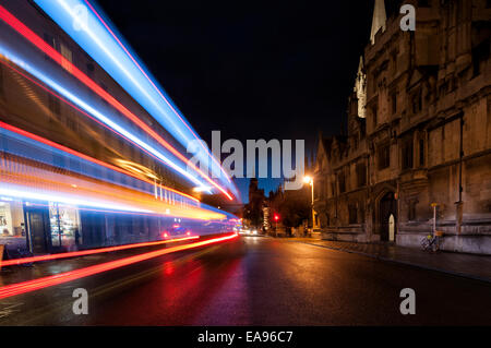 Oxford Hight Street at night with streaks of light from passing cars - Stock Photo
