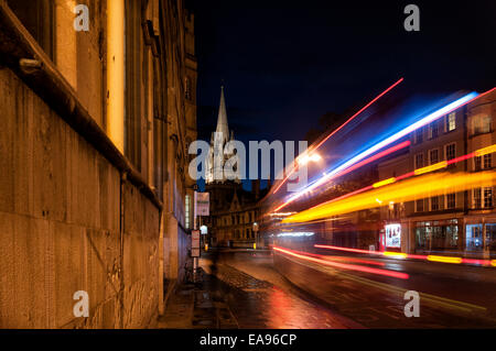 Oxford high street at night with streaks of light from a passing bus - Stock Photo
