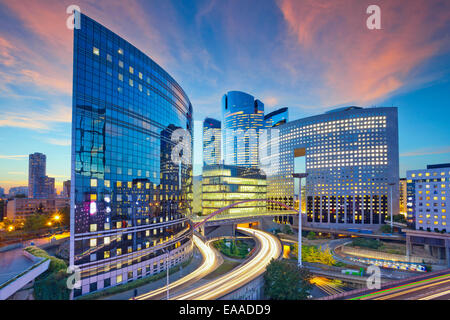 Image of office buildings in modern part of Paris- La Defense during sunset. - Stock Photo