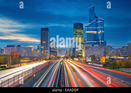 Image of office buildings in modern part of Paris- La Defense during twilight. - Stock Photo