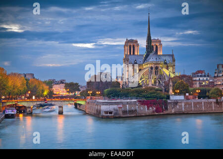 Image of Notre Dame Cathedral at dusk in Paris, France. - Stock Photo