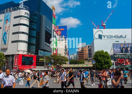 View of Shibuya Crossing, one of the busiest crosswalks in the world. Tokyo, Japan - Stock Photo