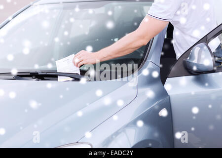 close up of man with parking ticket on car - Stock Photo