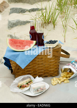 Picnic and picnic basket on the beach - Stock Photo