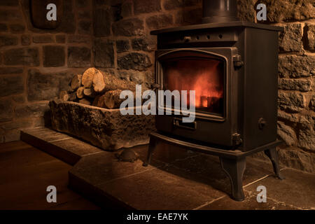 Cosy cottage sitting room with wood burning stove and linen stock photo royalty free image for Living room with wood burning stove