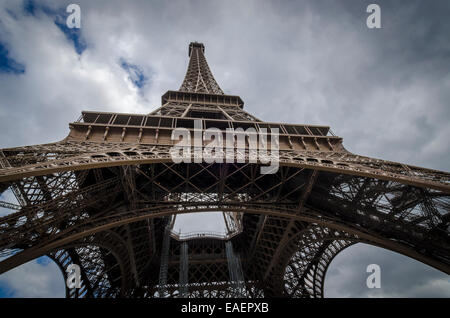 View of the Eiffel Tower from the bottom looking up - Stock Photo