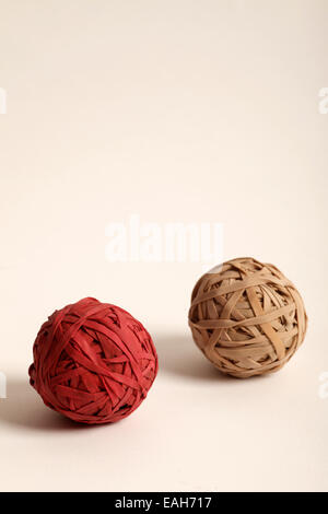 balls made up of red and fawn rubber bands - Stock Photo