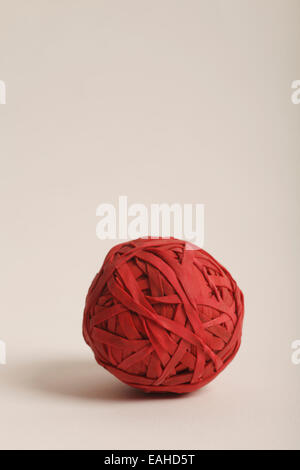 ball made up of red rubber bands - Stock Photo