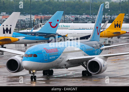 Thomson Airways Boeing 787-8 taxis to the terminal after arriving at Manchester Airport. - Stock Photo