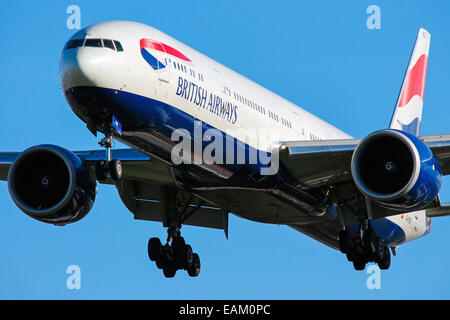 British Airways Boeing 777-300 approaches runway 27L at London Heathrow Airport. - Stock Photo