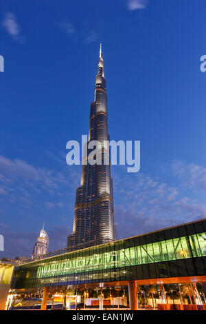 Modern architecture. Gangway to Dubai Mall and the tallest building  Burj Khalifa on the background in Dubai. - Stock Photo