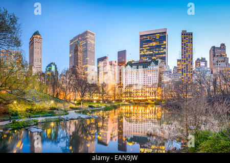 New York City, USA Manhattan cityscape from the Lagoon in Central Park. - Stock Photo