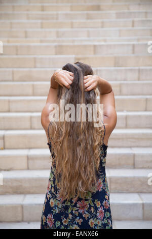 Young woman head in hands - Stockfoto