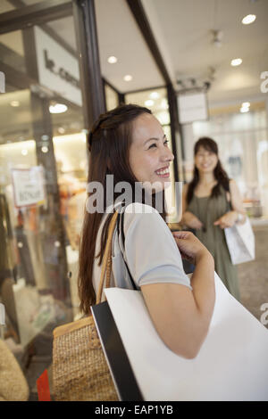 Mother and daughter on a shopping trip. - Stock Photo