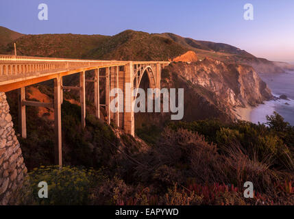 Bixby Bridge Pacific Coast Highway Big Sur California. Bixby Creek Canyon Bridge with coastline light streaks of - Stock Photo