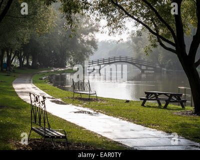 After the Rain in Stratford. A bridge over the Avon in the park below the festival theatre in Stratford, Ontario. - Stock Photo