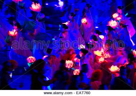 Dancers hold lotus lanterns in celebration of Buddha's birthday. - Stock Photo