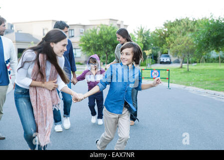 Family playing together outdoors - Stock Photo