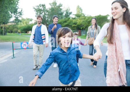 Family walking together outdoors - Stock Photo