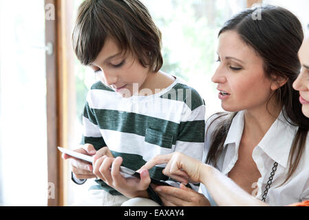 Family using digital tablet together - Stock Photo