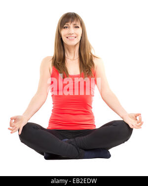 Young smiling fitness woman doing yoga exercises isolated on white background. Athletic girl in meditation pose - Stockfoto