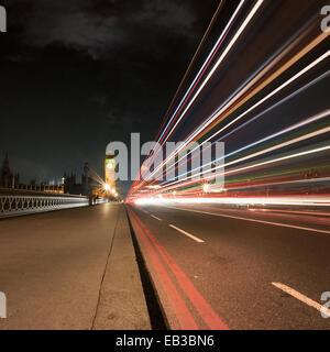 UK, England, London, Light trail on Westminster Bridge - Stock Photo