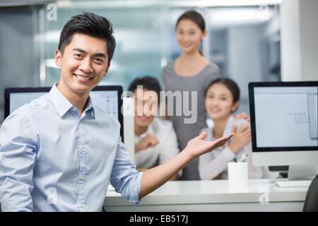 Portrait of young businessman in office - Stock Photo