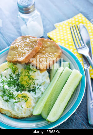 fried eggs and toasts on the plate - Stock Photo