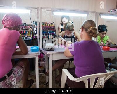 Manicurist at work - Stock Photo