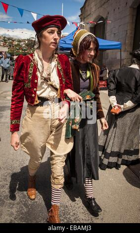 Ladies in Victorian dress promenade through historic precinct, Victorian festival, Oamaru, Otago - Stock Photo