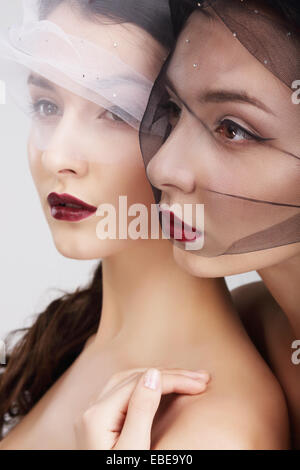 Fondness. Two Females in Veils Embracing - Stock Photo