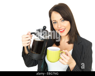 Attractive Business Woman Pouring Coffee - Stock Photo