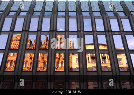 Old style buildings reflected in windows of a more modern block, West George Street, Glasgow, Scotland - Stock Photo