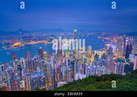 Hong Kong. Image of Hong Kong with many skyscrapers during twilight blue hour. - Stock Photo