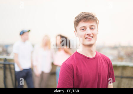 Young man wearing red t shirt - Stock Photo